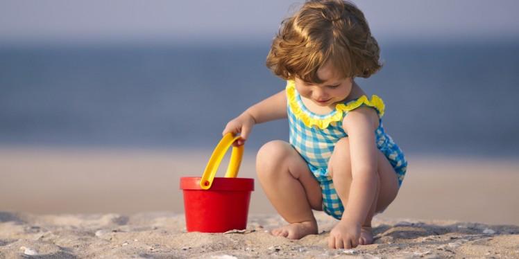 o-toddler-playing-in-sand-facebook