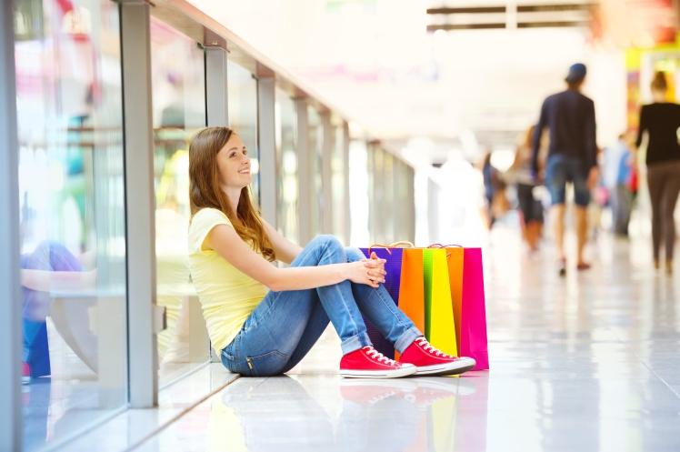 broke girl sitting in the mall